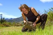Happy Tourist Lifts 'Smiling' Turtle