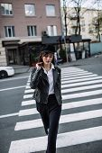 Beautiful Girl With Sunglasses. A Model In A Stylish Wide-brimmed Hat At A Pedestrian Crossing. Harm poster