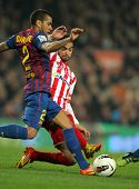 BARCELONA - MARCH 3: Dani Alves(L) of FC Barcelona vies with Nacho Cases(R) of Sporting Gijon in act
