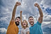 We Can Do It. Woman And Men Look Successful Celebrate Victory Sky Background. Threesome Stand Happy  poster