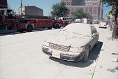 NEW YORK - SEPTEMBER 11: Ash covers a vehicle as it lies near the area known as Ground Zero after th