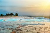 Beautiful vivid sunset over the travertine terraces and pools at Pamukkale, Turkey poster
