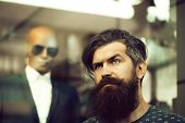 Handsome Bearded Young Man Hipster With Long Beard And Mustache Has Stylish Hair On Serious Hairy Fa poster