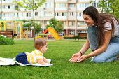 Adorable Little Baby Crawling Towards Mother Outdoors poster