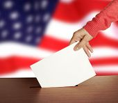 stock photo of ballot-paper  - Hand with ballot and box on Flag of USA - JPG