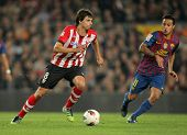 BARCELONA - MARCH, 31: Ander Iturraspe(L) of Athletic Bilbao vies with Thiago Alcantara(R) of Barcel