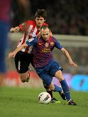 BARCELONA - MARCH, 31: Ander Iturraspe(L) of Athletic Bilbao vies with Andres Iniesta(R) of Barcelon