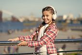 Make Your Kid Happy With Best Rated Kids Headphones Available Right Now. Girl Child Listen Music Out poster