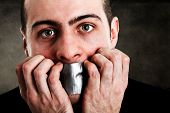picture of tyranny  - Man with mouth covered by tape - JPG