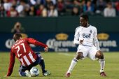 CARSON, CA. - JUNE 1: Chivas USA player M Ben Zemanski #21 (L) & Vancouver Whitecaps FC player M Gershon Koffie #28 (R) during the MLS game on June 1 2011 at the Home Depot Center in Carson, CA.