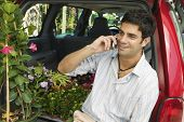 Man Using Cell Phone at Plant Nursery