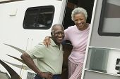 stock photo of early 60s  - Couple with Their RV - JPG