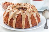 Sweet Potato And Pecan Nuts Pound Cake With Caramel Icing On A White Plate, Horizontal poster