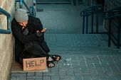 A Man, Homeless, A Person Asks For Alms On The Street With A Help Sign. Concept Of Homeless Person, poster