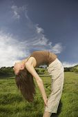 foto of bending over backwards  - Woman bending backwards - JPG