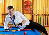 Billiard handsome player man drinking some alcohol in club