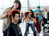 MOSCOW, - APRIL 01:contestant makes hairstyle for model on The XV Championship of Moscow on hairdres