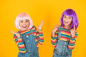 Happy Little Girls. Anime Fan. Cheerful Friends In Colorful Wigs. Anime Convention. Anime Cosplay Pa poster