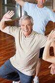 Dancing elderly man in fitness center class