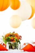 a green and orange wedding centerpiece on a table