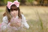 pic of lolita  - japanese woman in sweet lolita cosplay lying in meadow - JPG