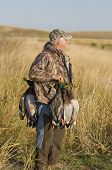 image of duck-hunting  - Hunter with a strap of Mallard Ducks from a morning hunt - JPG