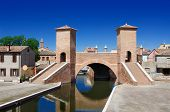 foto of ferrara  - View of the historical Trepponti bridge symbol of Comacchio Ferrara Emilia Romagna Italy - JPG