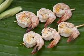 fresh shrimp on a green banana leaf