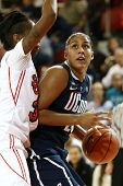 JAMAICA-FEB 2: Connecticut Huskies forward Kaleena Mosqueda-Lewis (23) is defended by St. John's Red