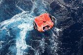 stock photo of safe haven  - Life raft adrift in rough sea mid ocean - JPG
