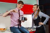 Portrait of Handsome man preparing food for his girlfriend in kitchen