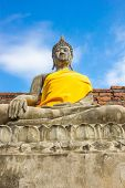 stock photo of scruple  - Stone Ancient Buddha statue of Thailand Temple - JPG