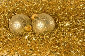 Two Gold Christmas Ornaments