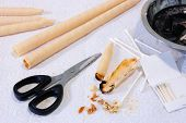stock photo of ear candle  - Assorted ear candling supplies and used ear candles with earwax - JPG
