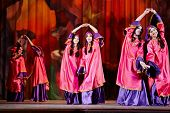 MOSCOW - JAN 28: Teenage dancing collective dressed in oriental dress dances on stage of Red October