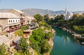 MOSTAR, BOSNIA - AUGUST 10: View of old town from Stari Most bridge on August 10, 2012 in Mostar, Bo