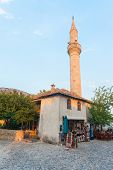 MOSTAR, BOSNIA - AUGUST 9: Small souvenir shop with minaret in background on August 9, 2012 in Mosta