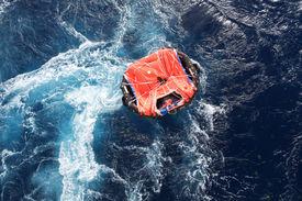 foto of safe haven  - Life raft adrift in rough sea mid ocean - JPG