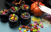 Halloween Trick Or Treat Party Table With Witch Hat And Cauldrons Full Of Candy, Ornage Pumpkin, Jac