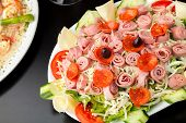 image of kalamata olives  - A delicious looking tossed chefs salad or antipasto with meat cheese and kalamata olives - JPG