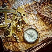 vintage  still life with compass,sextant and old map.  map used for background is in Public domain. Map source: Library of Congress. Country: Belgium Year: 1570. Author: Abraham Ortelius (1527-1598)