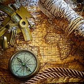 vintage  still life with compass,sextant and old map.  map used for background is in Public domain.
