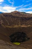 stock photo of bromo  - Crater of Bromo volcano against blue sky with clouds - JPG