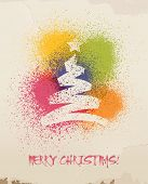 Christmas greetings, spray painted, on wall.