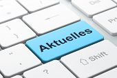 News concept: Aktuelles(german) on computer keyboard background