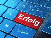 Finance concept: Erfolg(german) on computer keyboard background