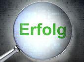 Finance concept: Erfolg(german) with optical glass on digital ba