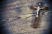 stock photo of prayer beads  - Beautiful old cross with jesus on the old wooden floor - JPG