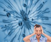 Composite image of stressed businesswoman with hand on her head on futuristic blue background