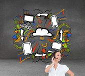 Composite image of cheerful smart call center agent working in front of economic illustrations in grey room